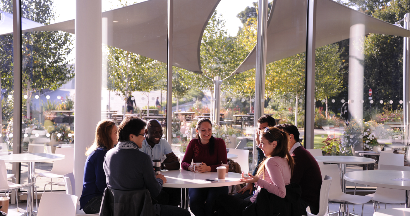 sanger institute researchers chatting at the wellcome genome campus